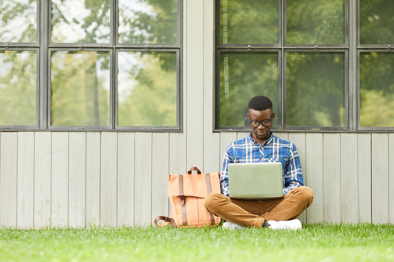 college-student-using-laptop-outdoors